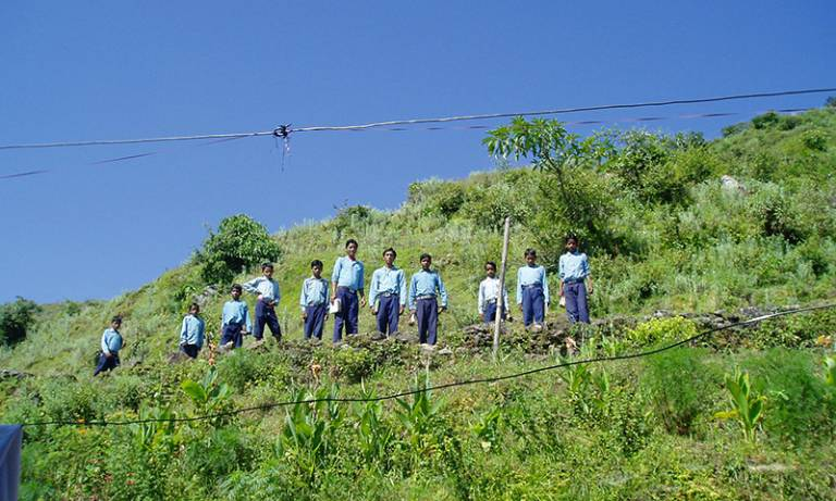 Male students standing on a hillside