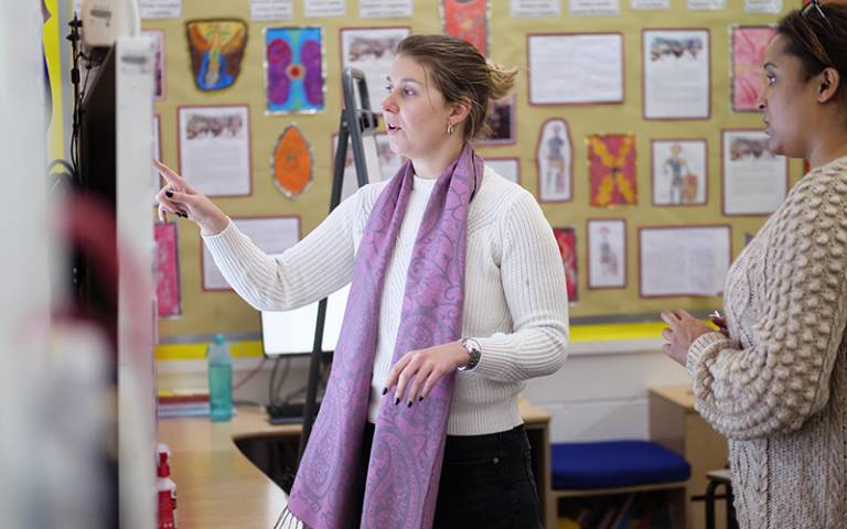 Two teachers standing in classroom and talking. Image: Phil Meech for UCL Institute of Education