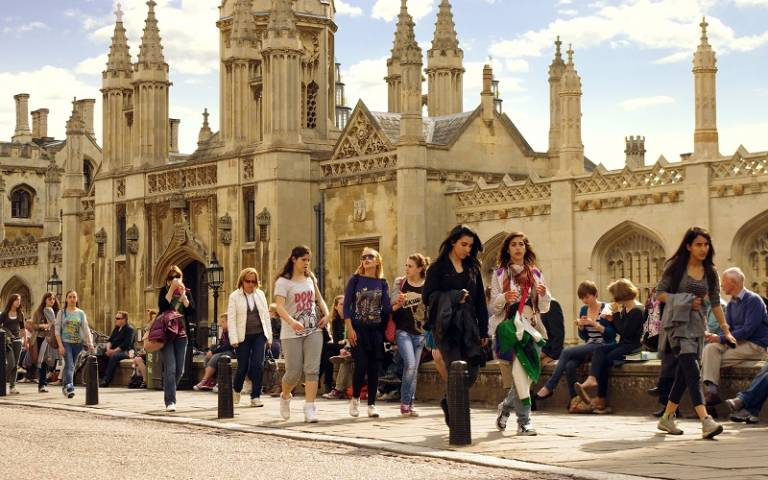 People walking in front of King's College Gatehouse, Cambridge. Image by Kosala Bandara via Flickr (CC BY 2.0).