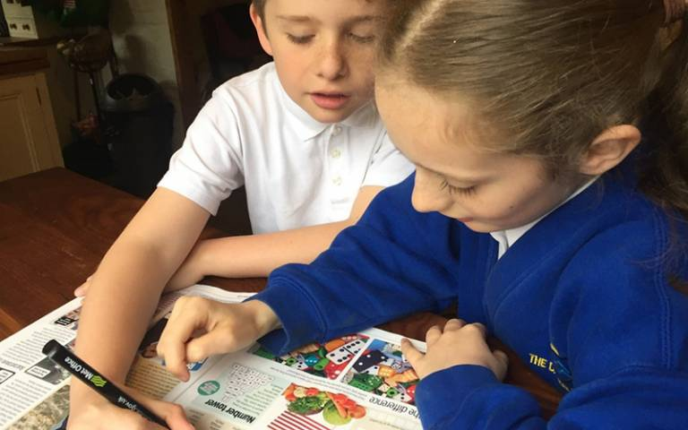 Primary school girl and boy working together