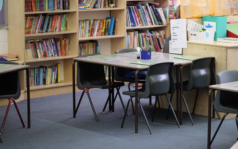 Chairs, tables, bookshelves in a primary school classroom
