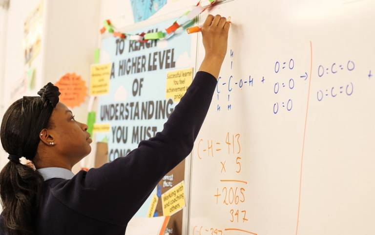 Pupil solving equation on classroom whiteboard. Image: Phil Meech for UCL Institute of Education