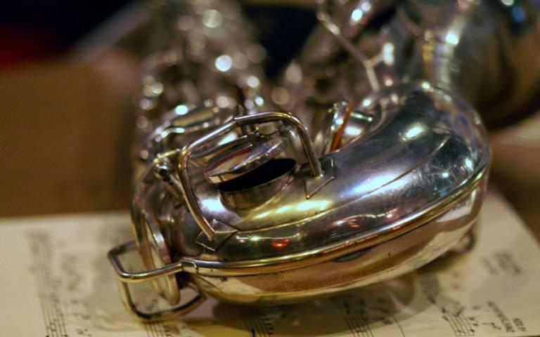 Saxophone resting on sheet music