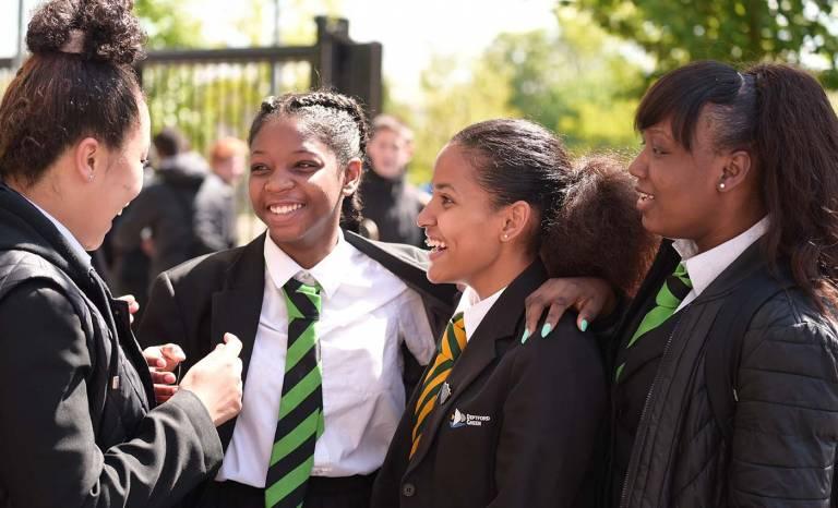 School girls laughing
