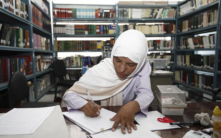 Woman studying in Balkh University library, Afghanistan. Image: Sandra Calligaro / Taimani Films / World Bank (CC BY-NC-ND 2.0)