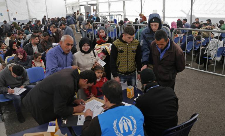 A family submitting an application at the UNHCR registration center in Tripoli, Lebanon.