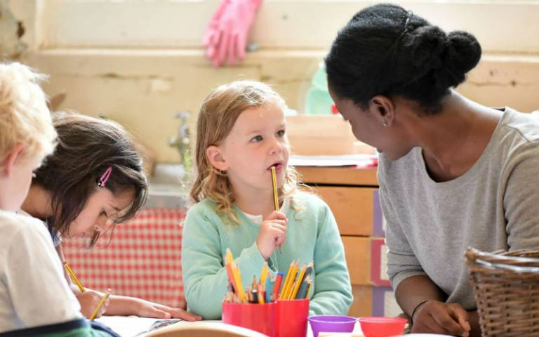 Teaching Assistant and child