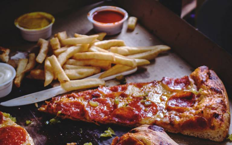 Pizza and chips in takeaway box