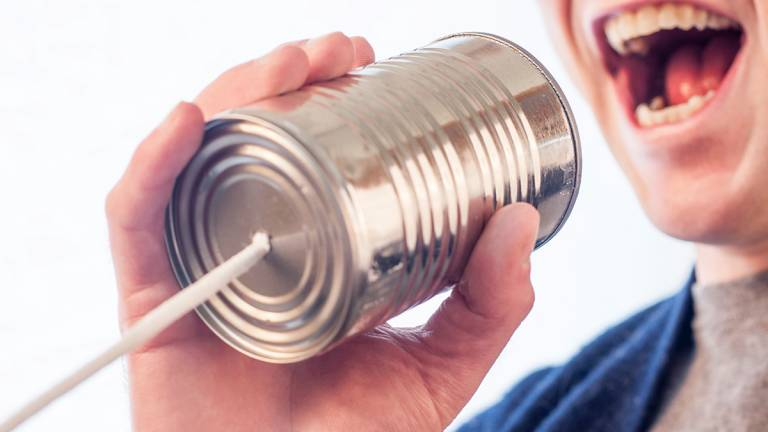 Speaking on a tin can and string telephone