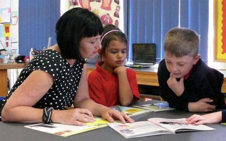 Teaching assistant with pupils