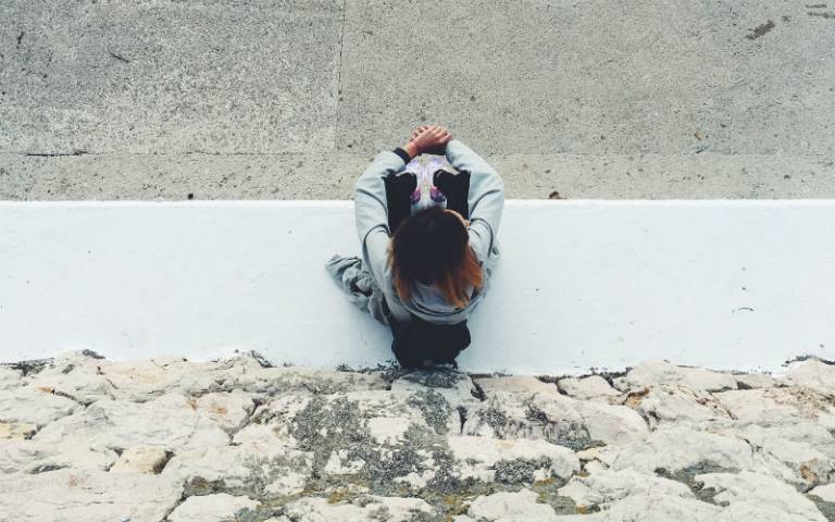 Teenage girl sat alone