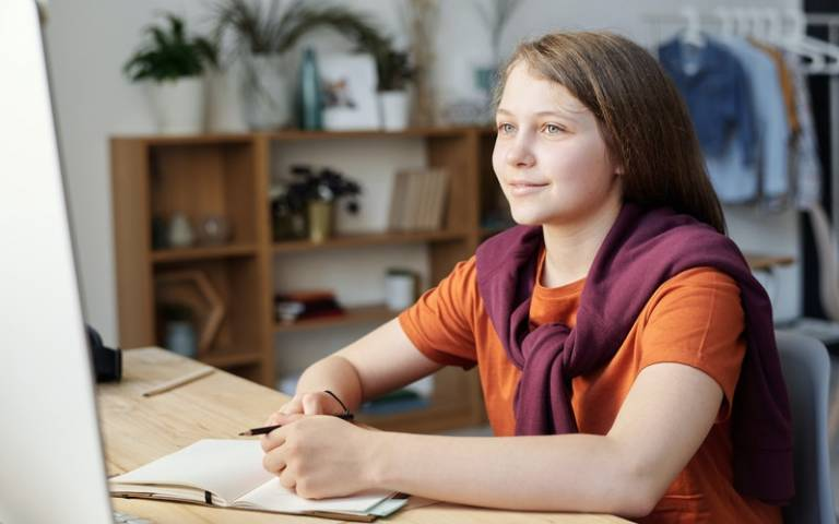 Teenager looking at computer screen. Image: Julia M Cameron via Pexels