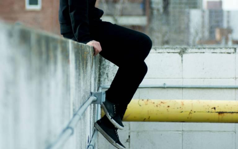 Teenager sat on wall