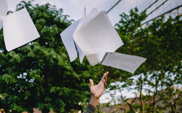Papers thrown into the air (Photo: Ketut Subiyanto from Pexels)