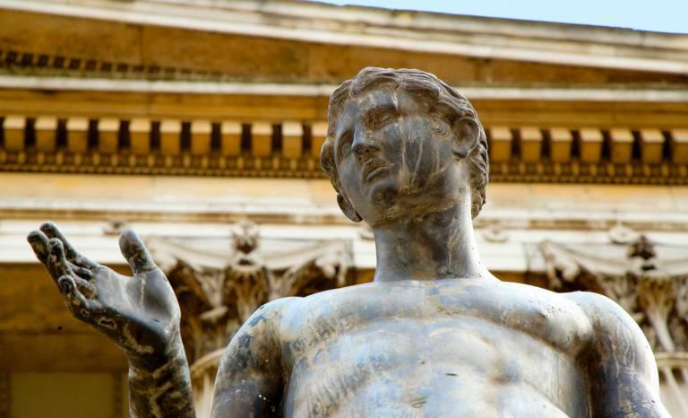 UCL Portico statue