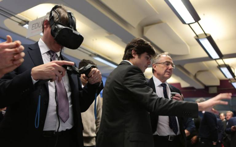 Universities minister wears a virtual reality headset during a visit to the IOE's EDUCATE programme