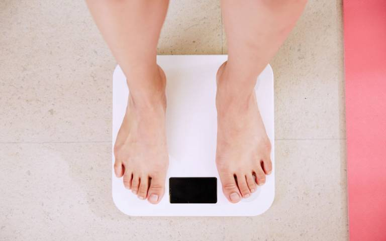 Person stood on weighing scales