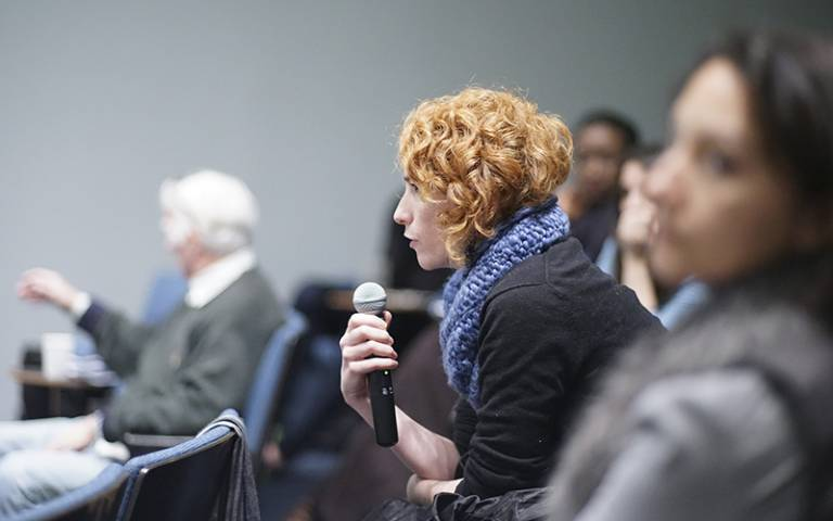 Woman in audience asking a question. Image: Justin Lui via Flickr (CC BY 2.0)