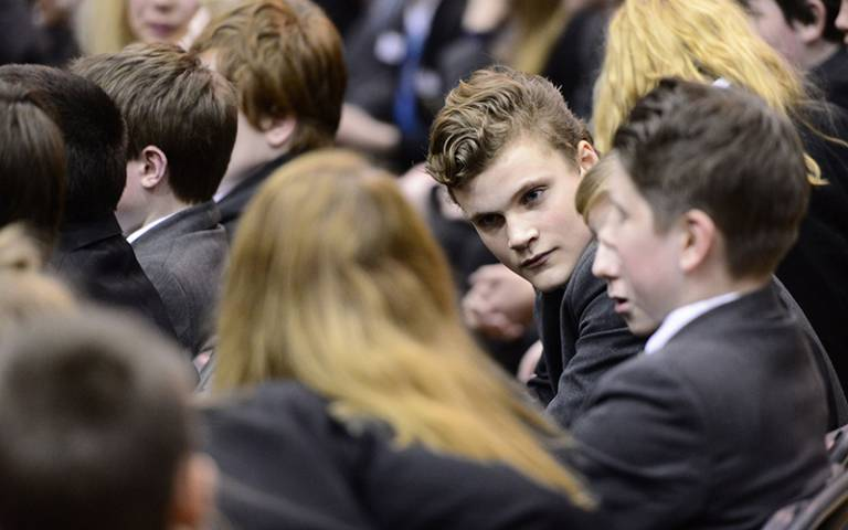 Year 9 boy talking to friends. Wellington College (CC BY-NC 2.0)