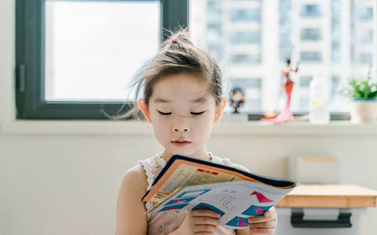 Girl reading book. Image:Jerry WangviaUnsplash