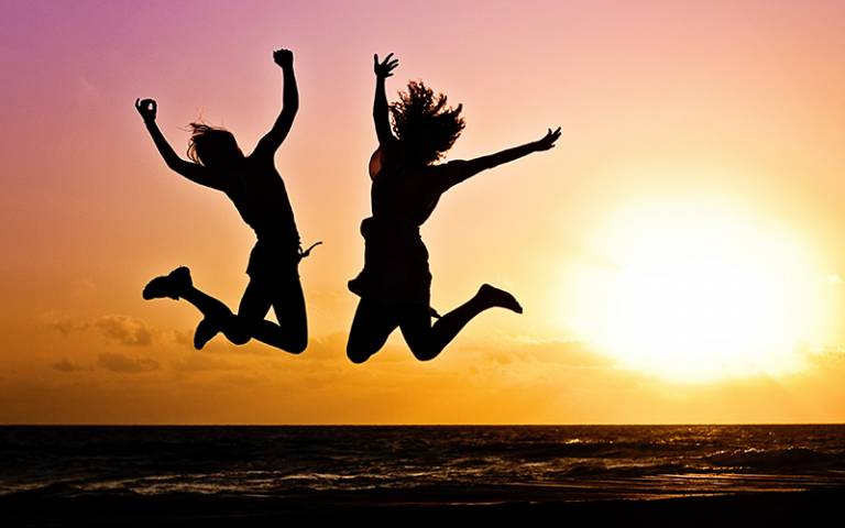 Teenagers jumping in front of sunset