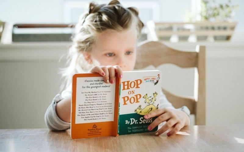 Child reading at the table. Image: Josh Applegate via Unsplash