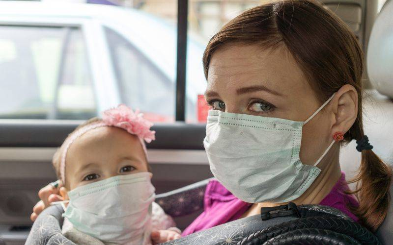 Mother and child sitting with masks on. Image: David Veksler via Unsplash