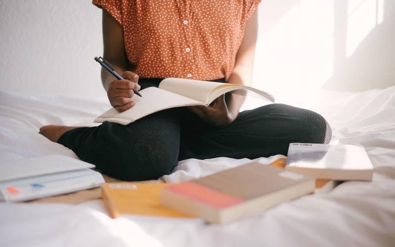 Student studying with books. Image: Retha Ferguson via Pexels