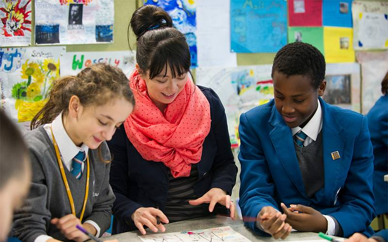Teacher and students learning in class. Image: Kirsten Holt for UCL