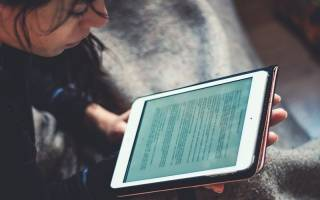 Woman reading from an iPad