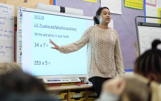 Teacher in classroom with interactive board. Image: Phil Meech for UCL Institute of Education