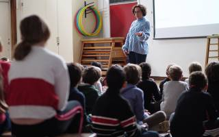 Teacher standing in front of primary class. Image: Phil Meech for UCL Institute of Education