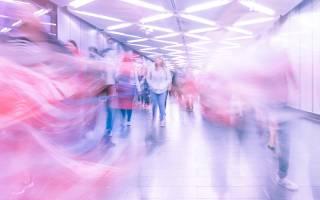Motion blur of people walking through a subway tunnel. Image: Martin Adams via Unsplash