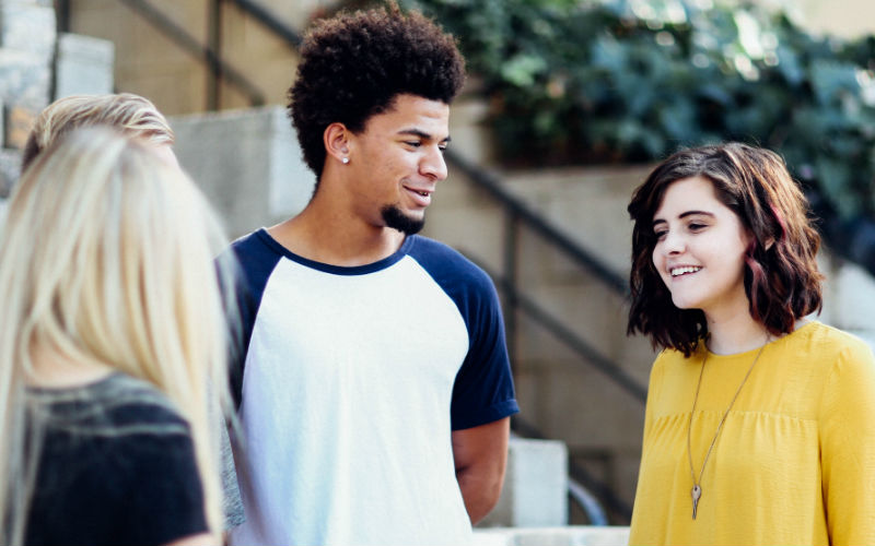 Young people talking outside
