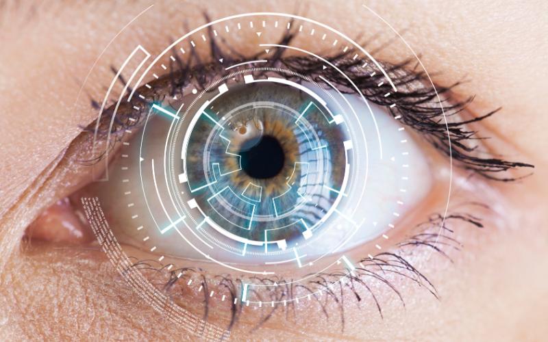 an eye with digital overlay graphics