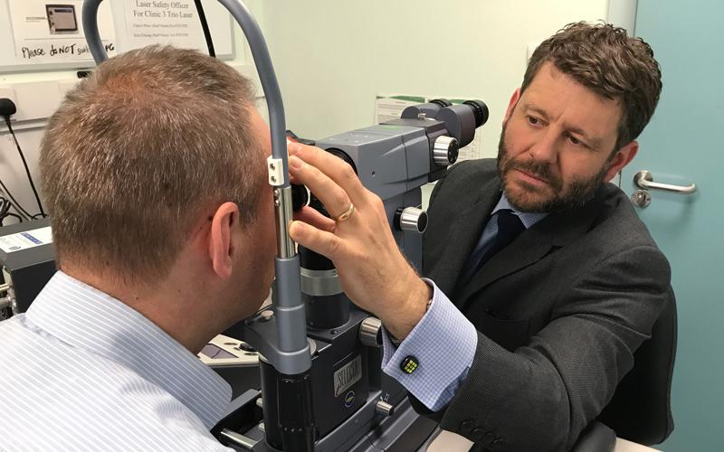 Gus Gazzard examining a patient