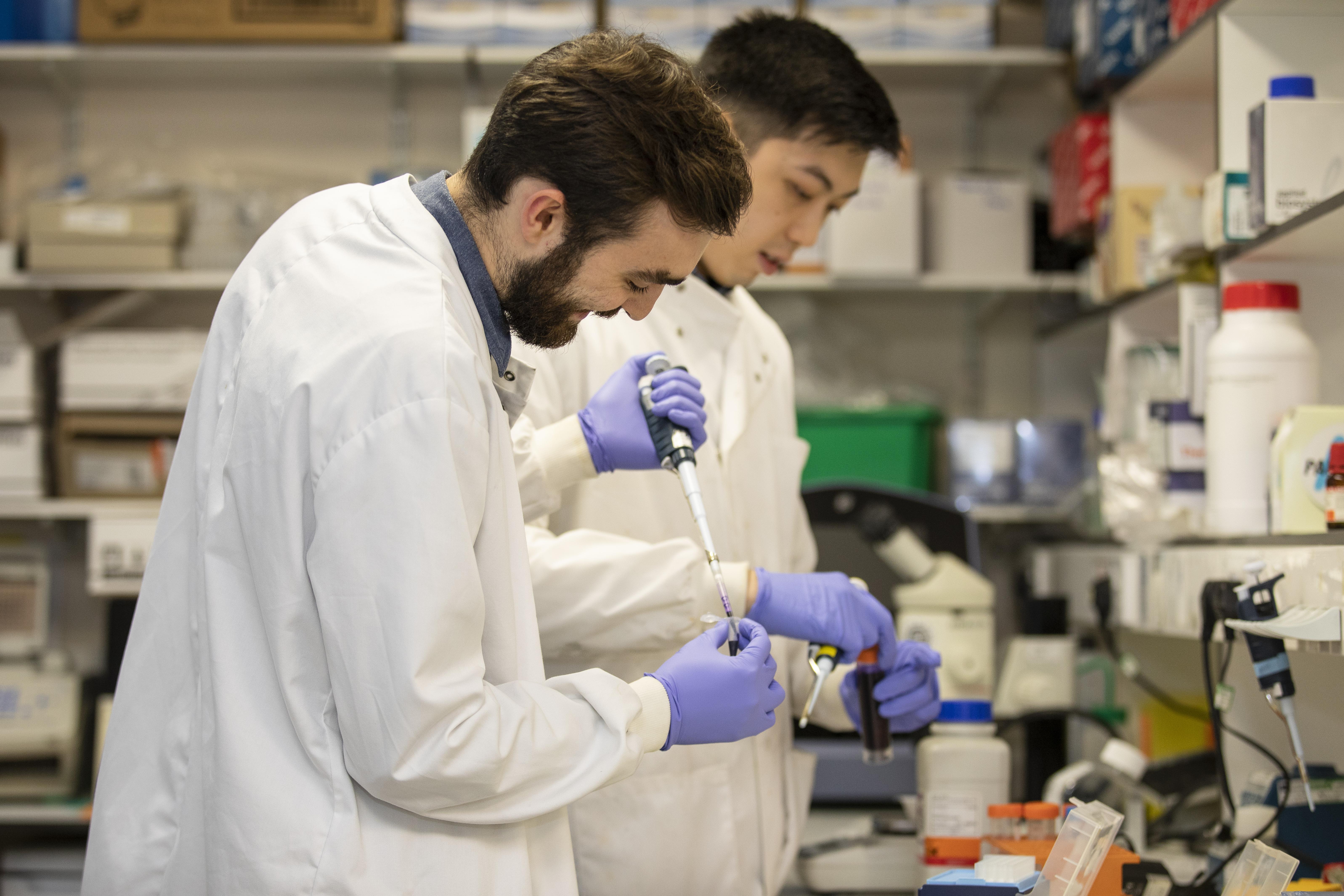 men in a lab