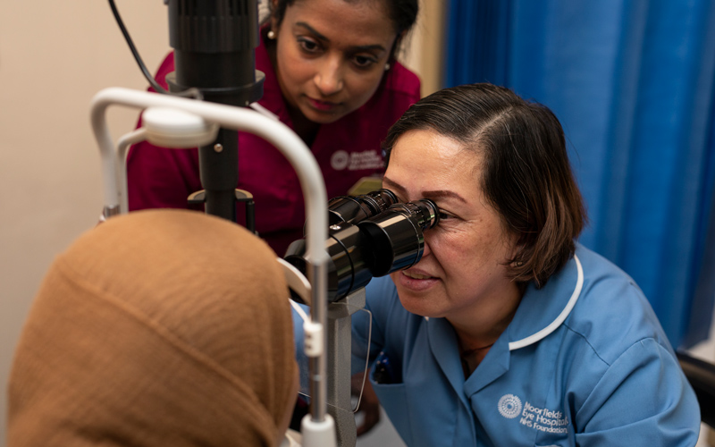 A female ophthalmic nurse examines a patient