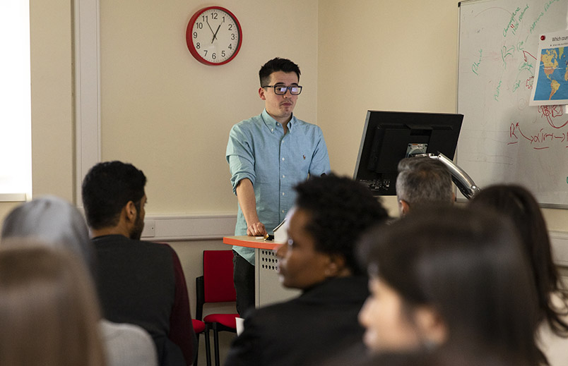 PhD students presenting