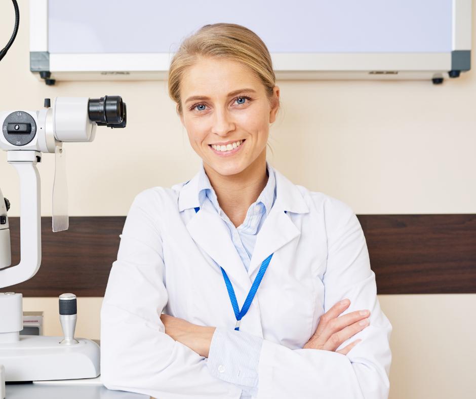female technician sitting by machine