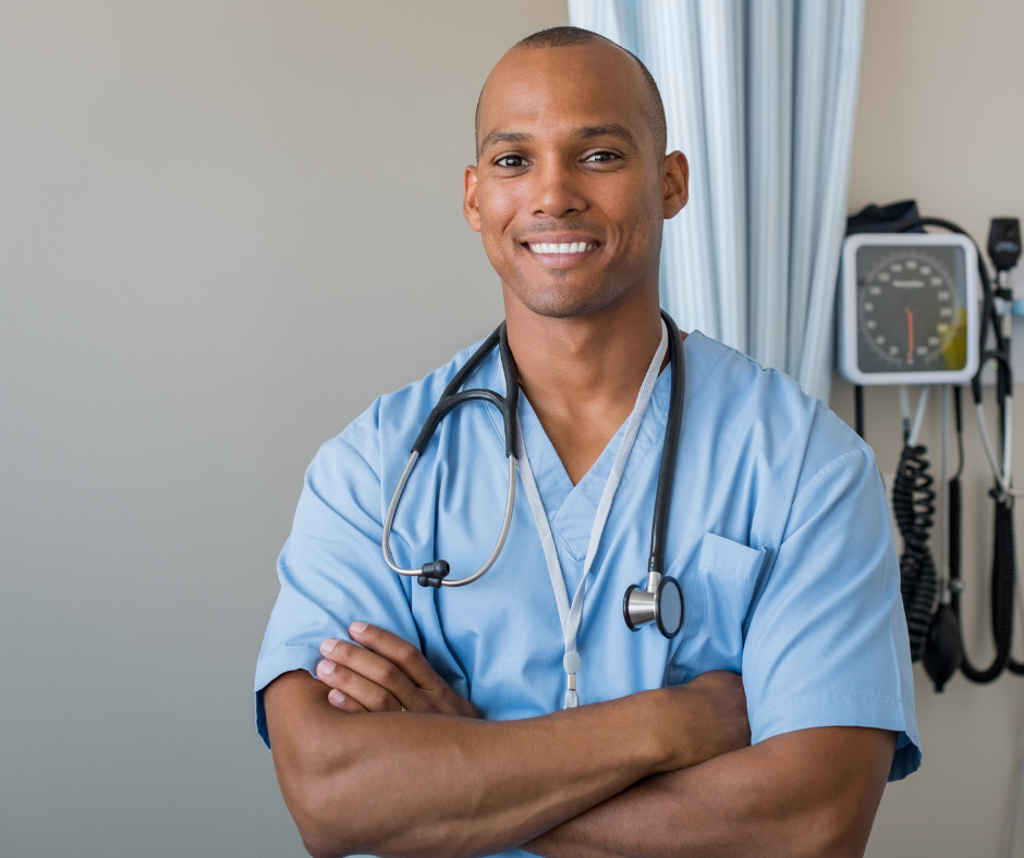 Smiling male nurse with arms folded