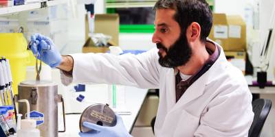 UCL researcher in lab in Institute of Ophthalmology