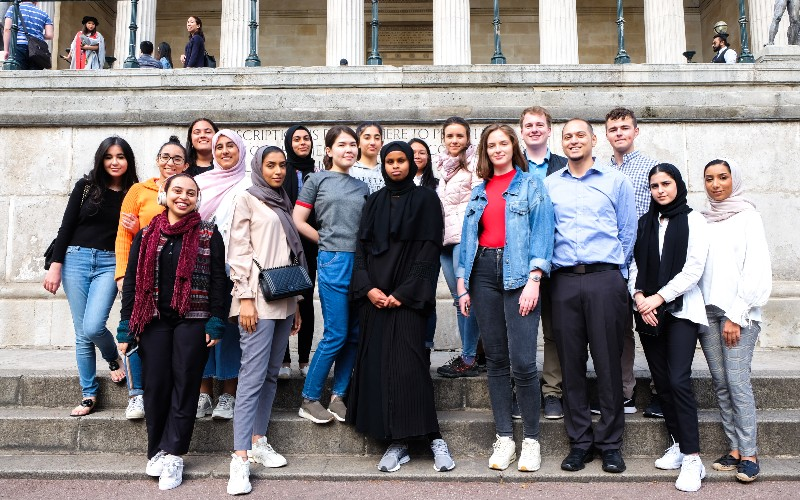 A group of IoO Summer School students in front the UCL Wilkins Building in London