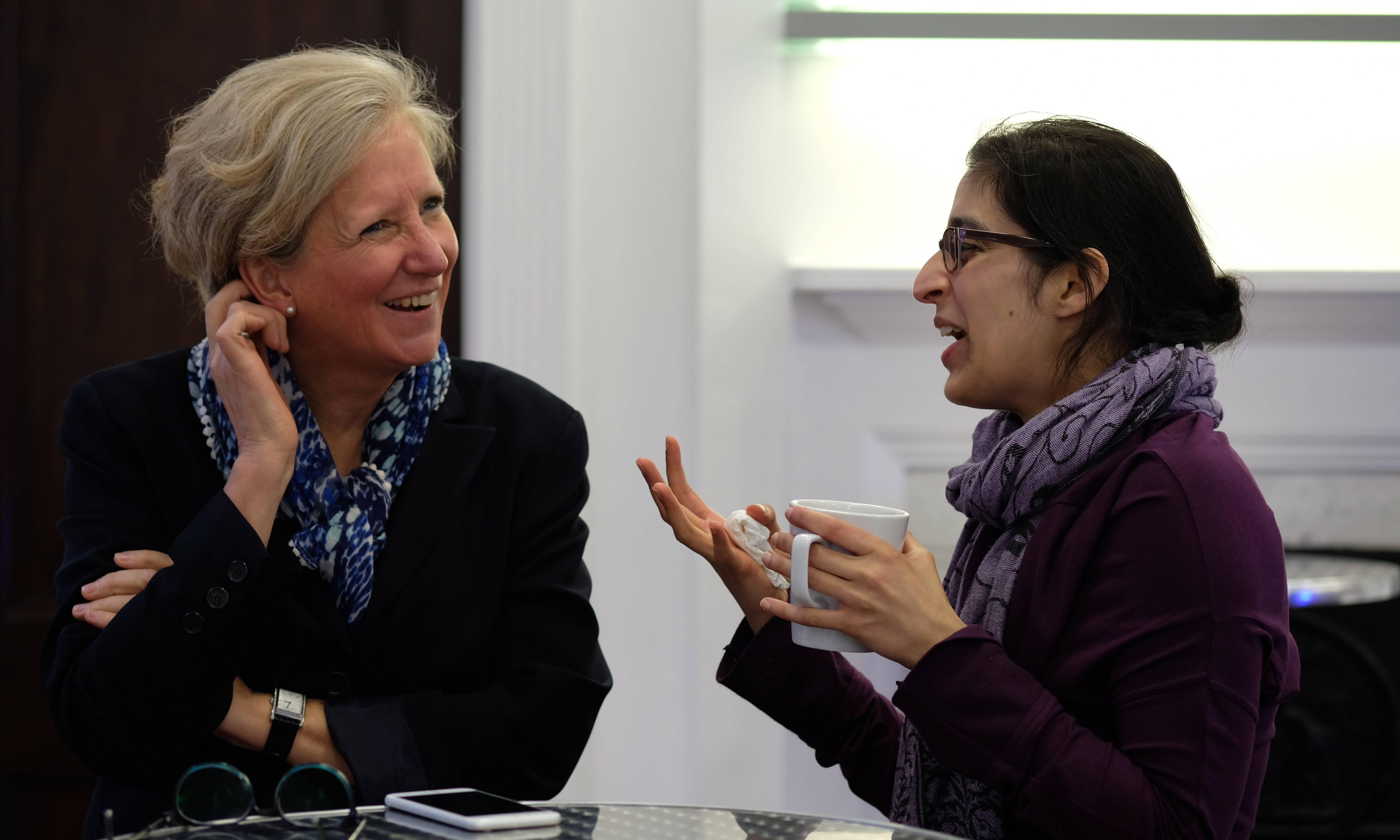 Professor Sarah Coupland (University of Liverpool, ARVO Vice President) sharing a joke over coffee during the networking session at the Women in Vision UK Inaugural meeting