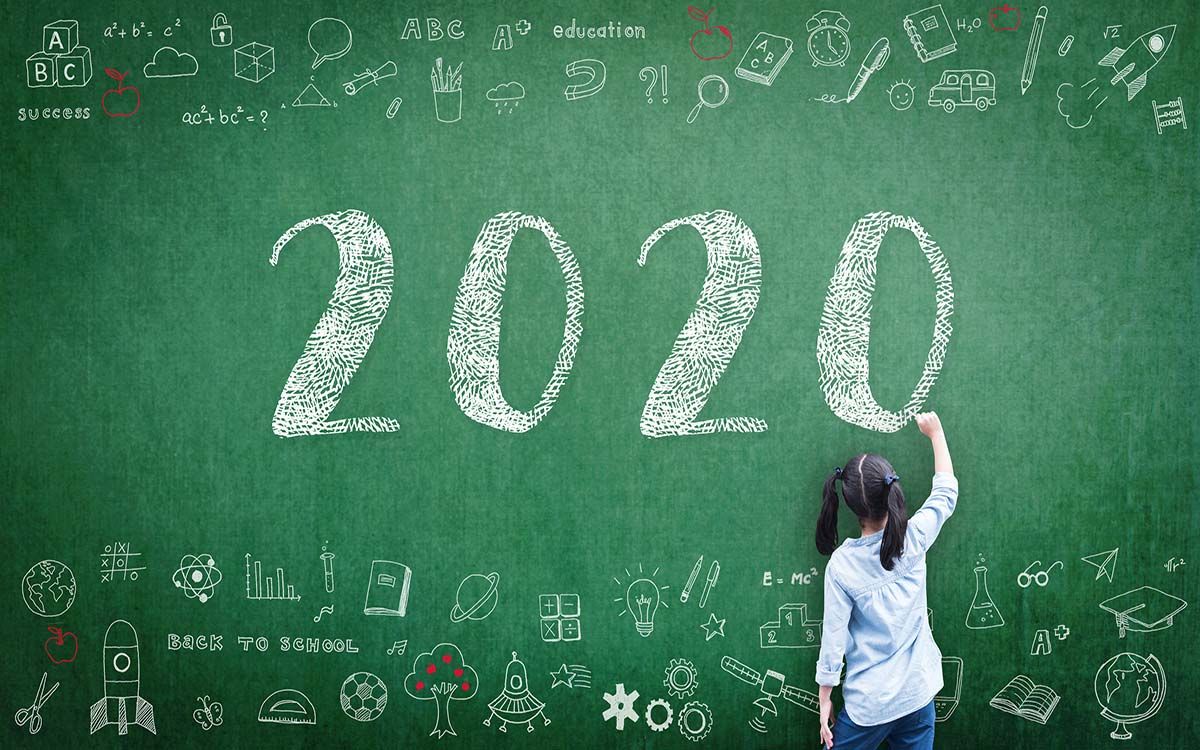 A blackboard with the year 2020 written on it