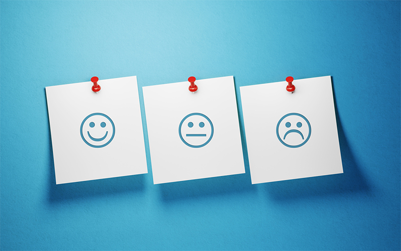 Happy and unhappy emojis on post-it notes