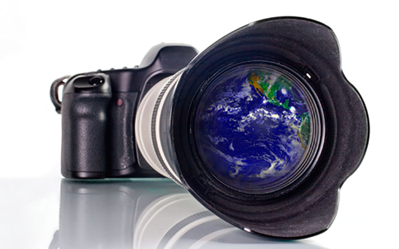 A camera with the world reflected in the lens