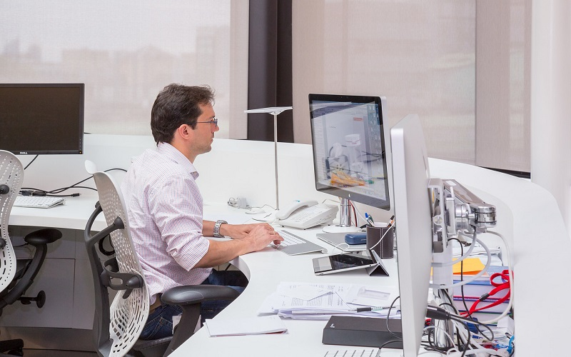 Picture of a member of staff  looking at a computer screen