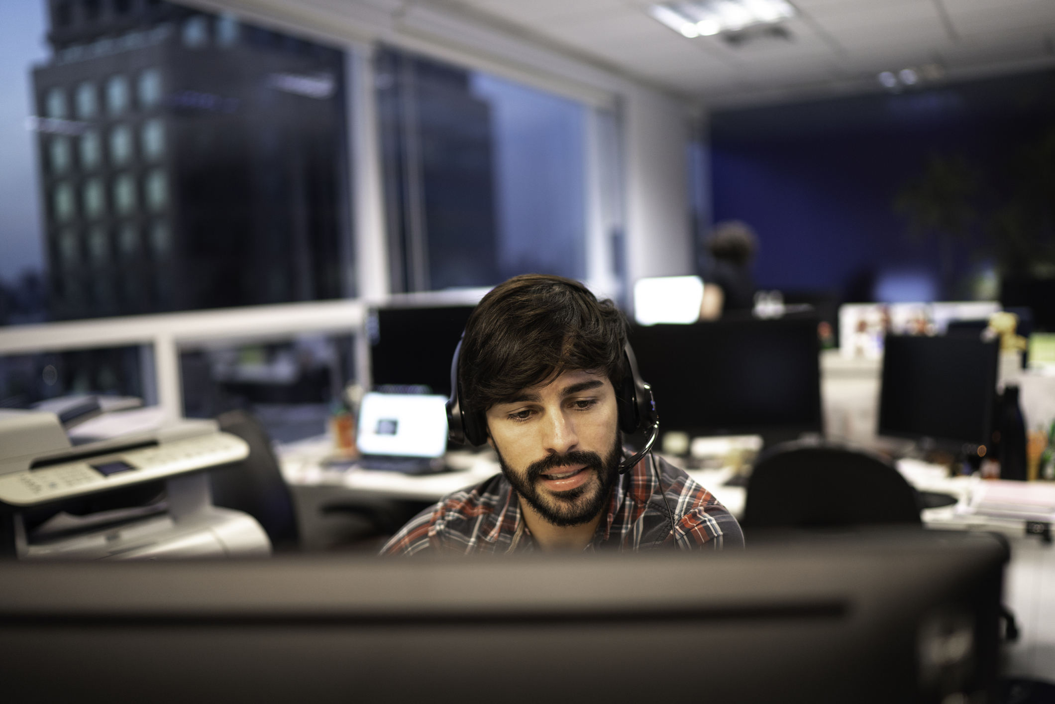 Employee working with headset in office