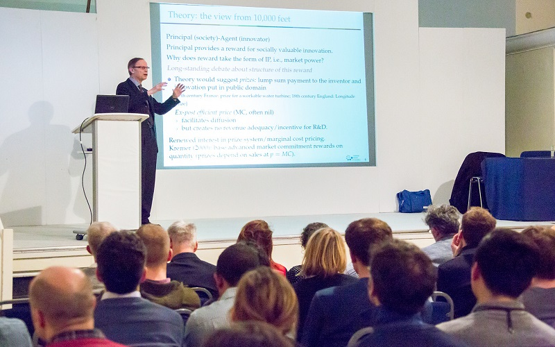 Picture of a lecturer pointing at a slide